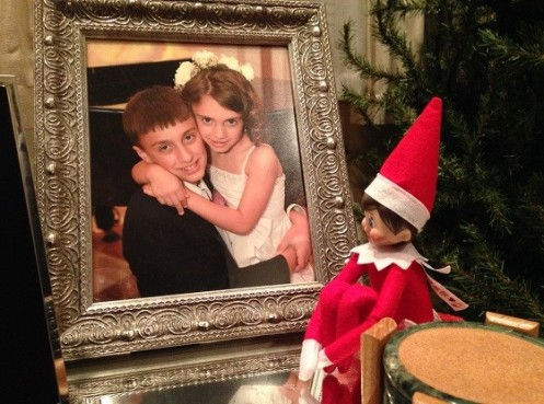 Day 10: We found Kira the Elf sitting next to a photo of the kids