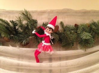 Day 12: We found Kira the Elf hanging from the garland on the front bay window