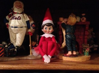 Day 18: We found Kira the Elf on the shelf with Mets Santa and the little boy hanging his stocking