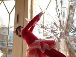 Day 21: We found Kira the Elf hanging from the snowflake in the front window like a wreckingball