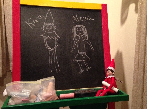 Day 6: We found Kira the Elf left a drawing on my daughters chalk board